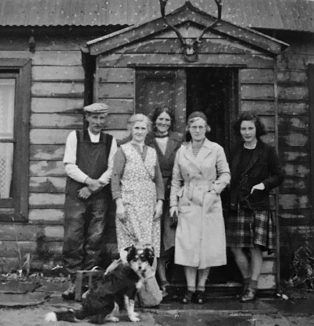 Nan Shepherd's shanty in the Cairngorms. Shepherd, the McGregors and Jean Roger stand in the doorway.