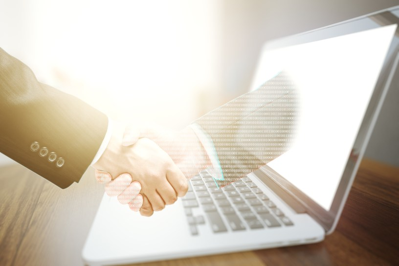 Businessman shaking hand with virtual partner. Online business concept