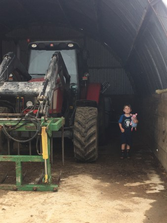 C and George the pig visiting a tractor