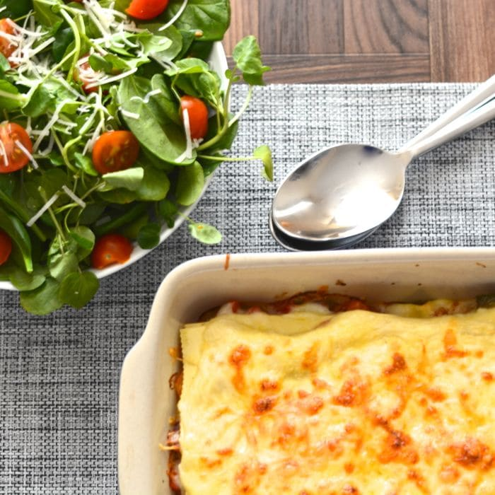 My delicious vegetarian lasagne recipe. Crammed full of roasted peppers, tomatoes and onions, and plenty of creamy homemade bechamel sauce and cheese.