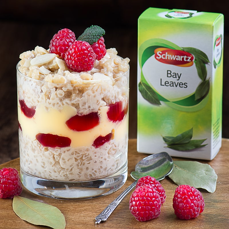Rice Pudding Trifle - Two of my favourite desserts in one, creamy rice pudding served with custard and raspberry jam... and an unusual secret ingredient!