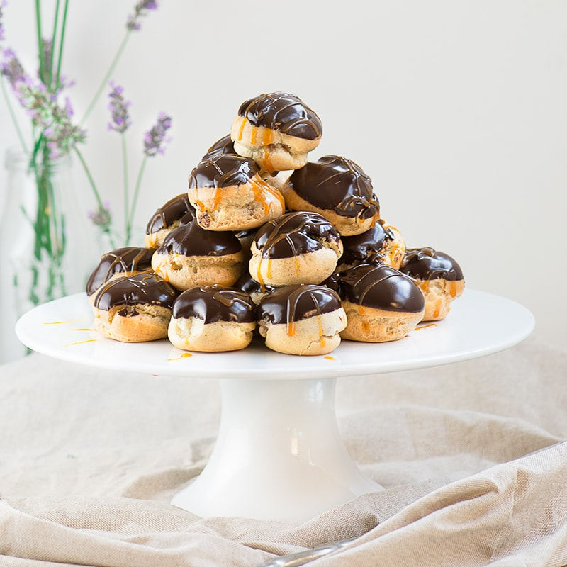 Double chocolate and caramel profiteroles - crisp choux pastry filled with milk chocolate mousse and topped withdark chocolate sauceand caramel.