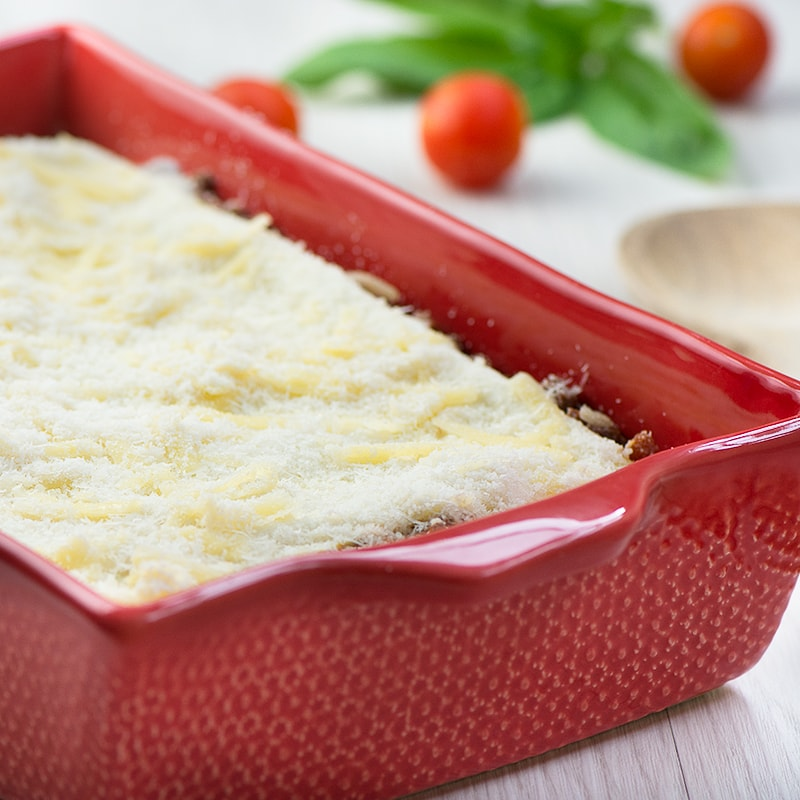 Delicious beef lasagne - layers of pasta filled with a rich beef bolognese, creamy béchamel sauce and plenty of grated cheese.