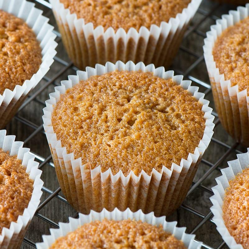 Caramel cupcakes on a cooling rack.