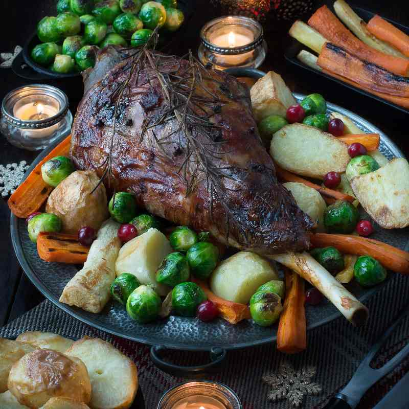 My festive roast leg of lamb flavoured with rosemary, cloves, orange and cranberries makes a fantastic alternative to turkey on Christmas day or to feed your family and friends over the festive period.