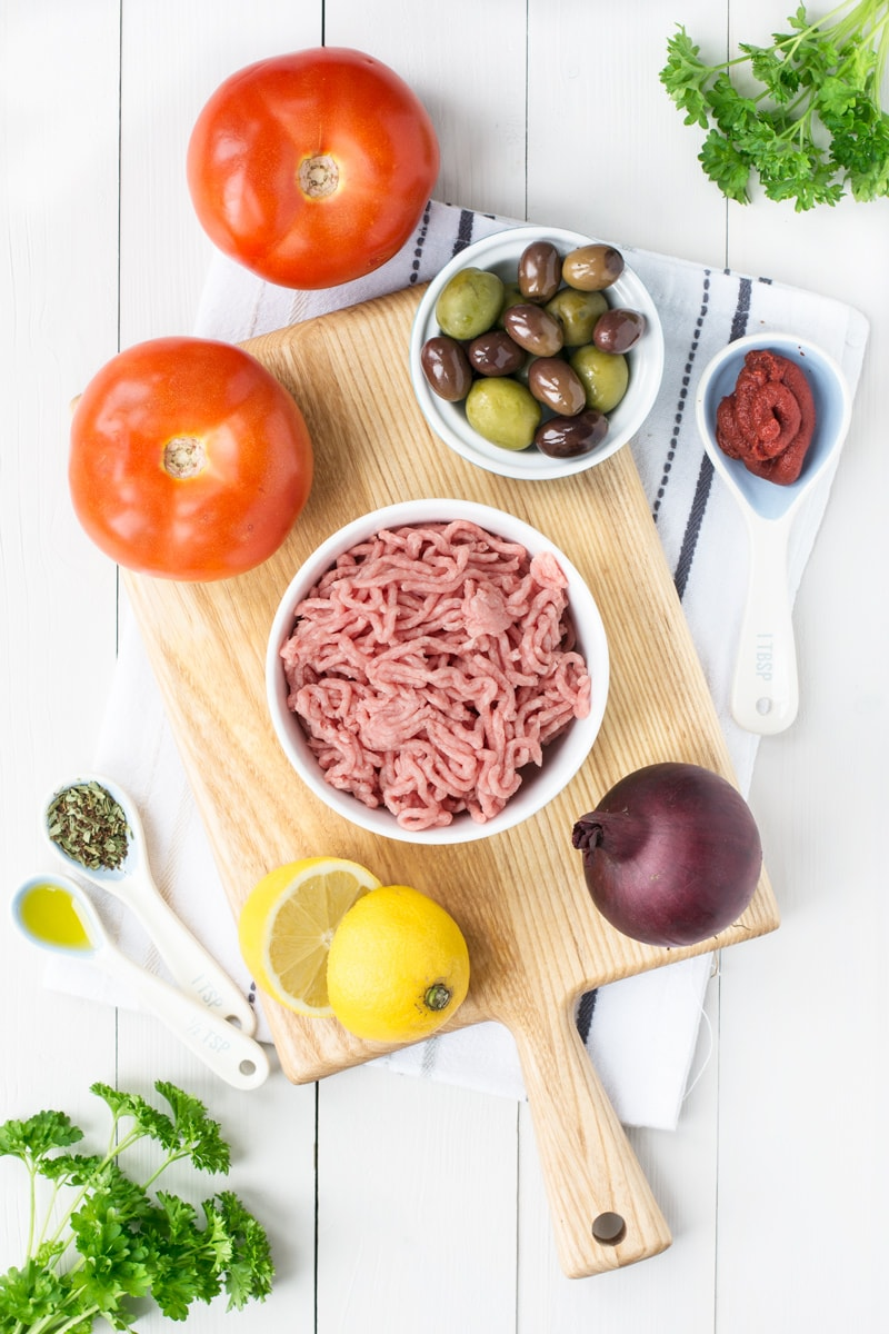 Ingredients for Mediterranean Lamb Stuffed Tomatoes - Tomatoes, mixed olives, lamb mince, red onion, lemon, tomato puree, olive oil, herbs and spices