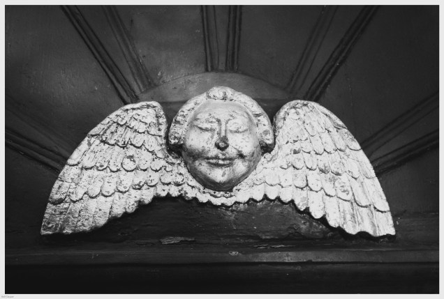Cherub above St. Luke's church door in Charlton