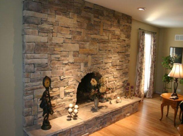 リビングルーム3で魅力的な積み重ねられた石造りの暖炉のデザインの暖かさを取得します。