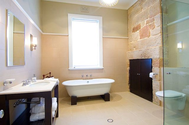 15-AD-Exposed-stone-inside-the-renovated-bathroom-adds-old-world-charm
