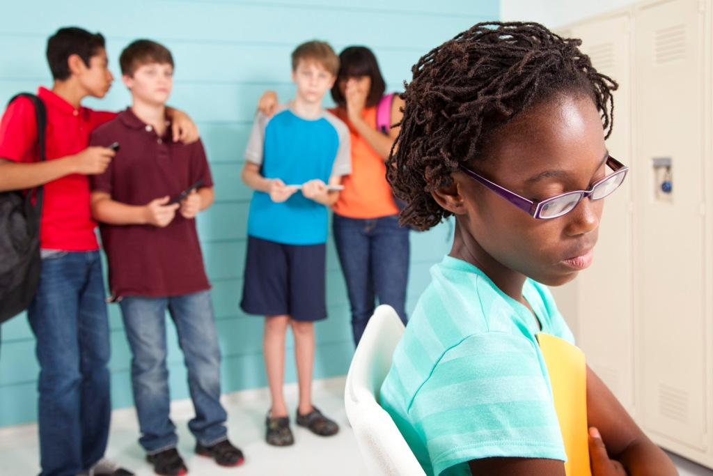 Getty Creative Stock image for Bullying  Teens using wireless technology at school to bully classmate