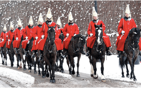 queen's guards in formal dress on horseback in snow