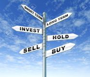 11404957-investing-guidance-stock-trading-buy-sell-hold-confusion-directions-traffic-street-sign-Stock-Photo