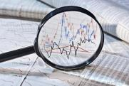 magnifying-glass-and-stock-charts
