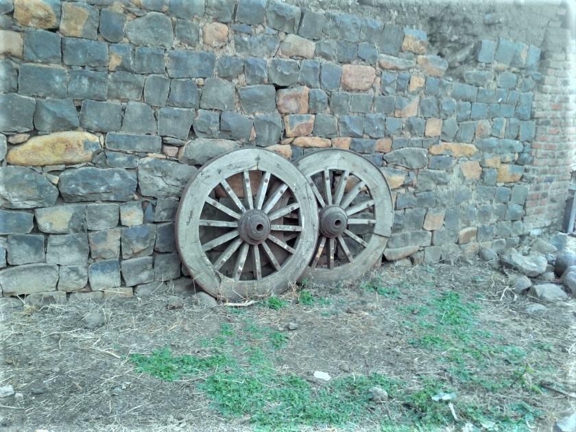 Bullock Cart Wheels Outside House in Village