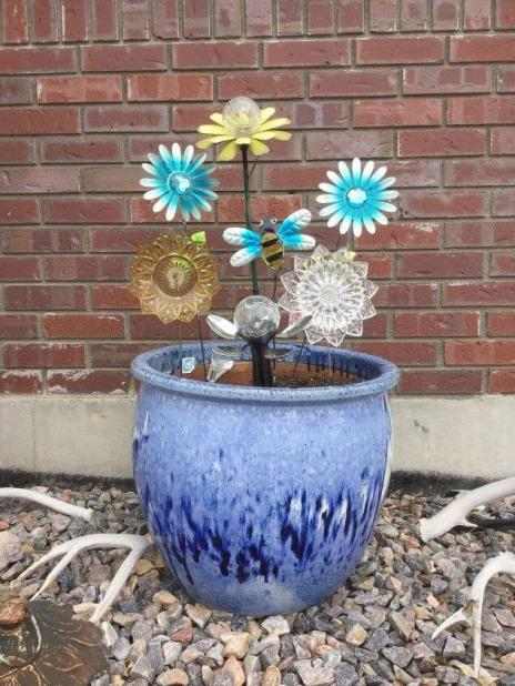 Garden Flowers Made From Dishes by Chas' Crazy Creations.