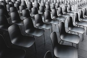 rows of chairs for public speaking audience