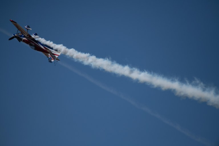 Lucas Oil sponsored plane, piloted by Brad Wursten, upside down in the air.