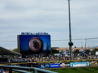 The readerboard with the Padres logo on a baseball.
