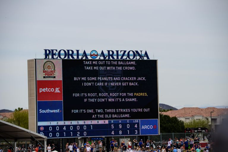 The lyrics to Take Me Out to the Ballgame on the scoreboard.