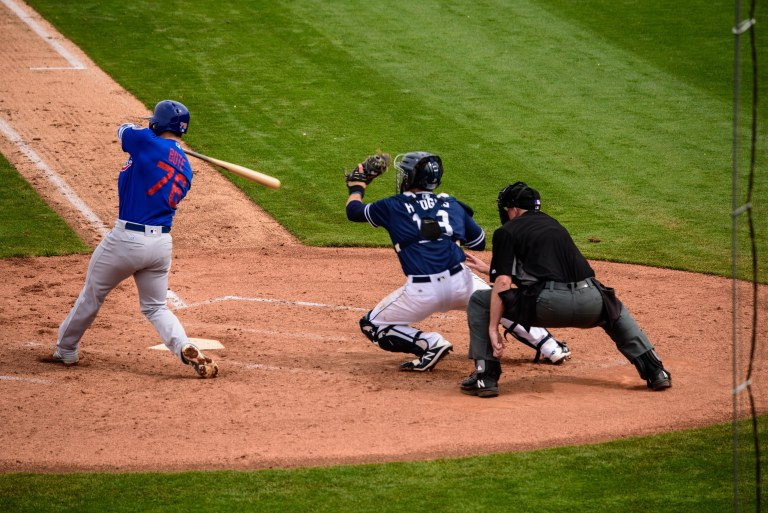 Cubs player at the end of a swing.