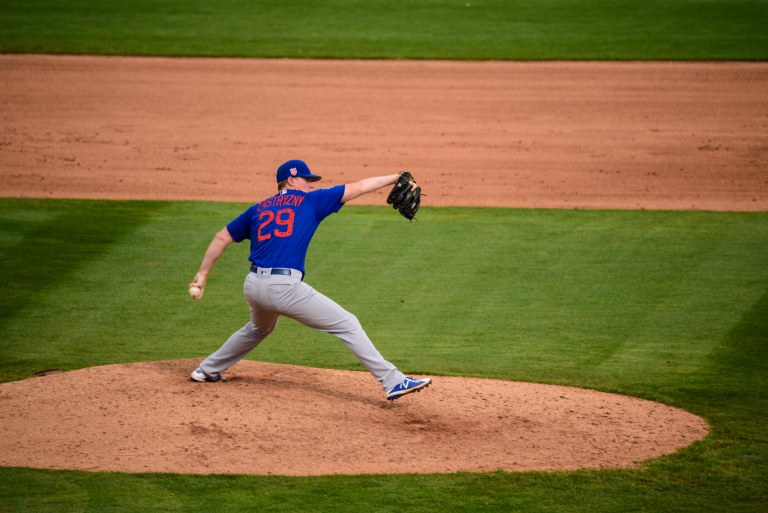 Cubs pitcher getting ready to throw.