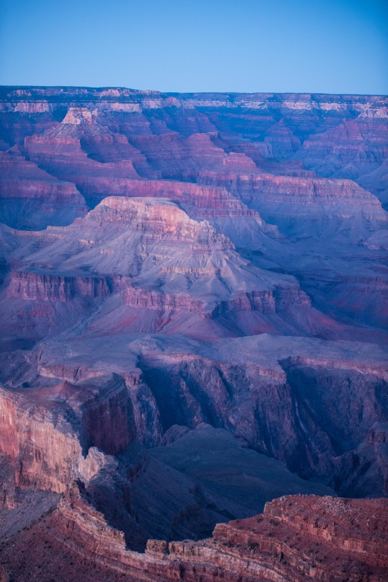 Spectacular canyon valleys bathed in golden hour hues.