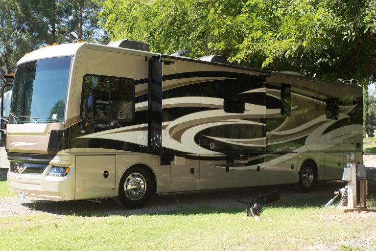 Our RV on a sunny day at an RV park.