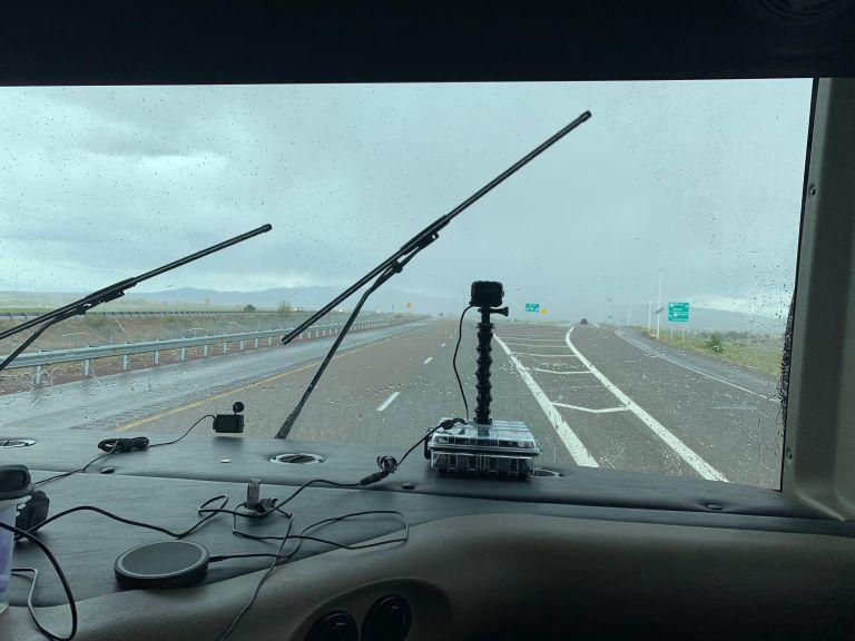 RV windshield capture of rain going through Santa Fe.