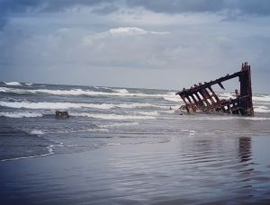 Waves coming in to pound the Peter Iredale shipwreck.