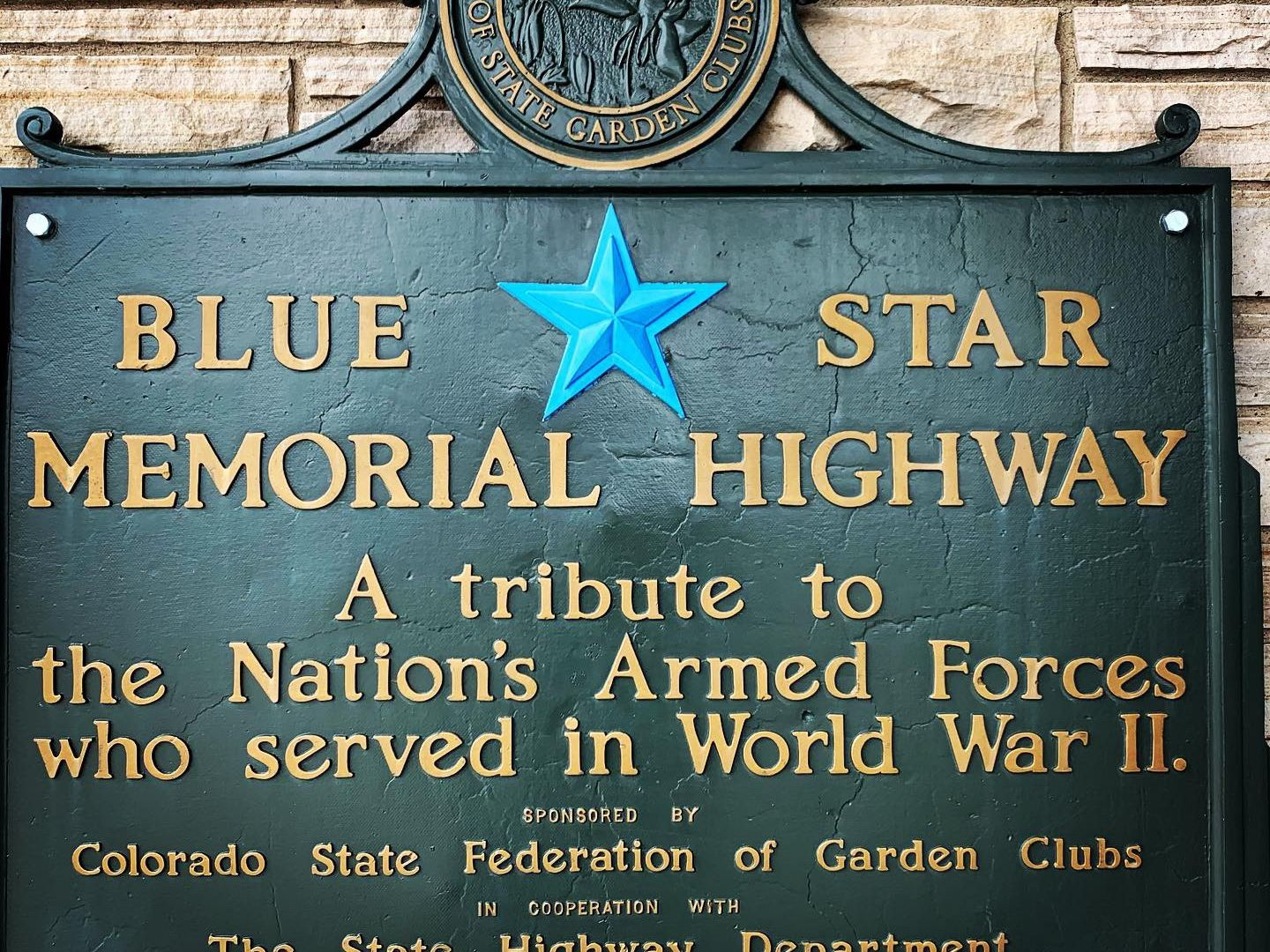 "Bronze plaque with wording ""Blue Star Memorial Highway"""