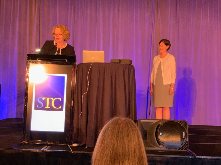 STC President Jane Wilson reading off the citation for Aiessa Moyna's President's Award.