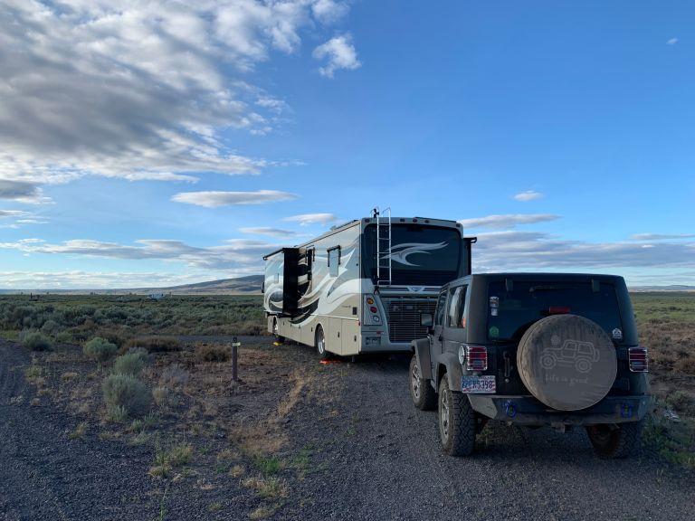 Our RV and Jeep Wrangler from behind in the camp site.