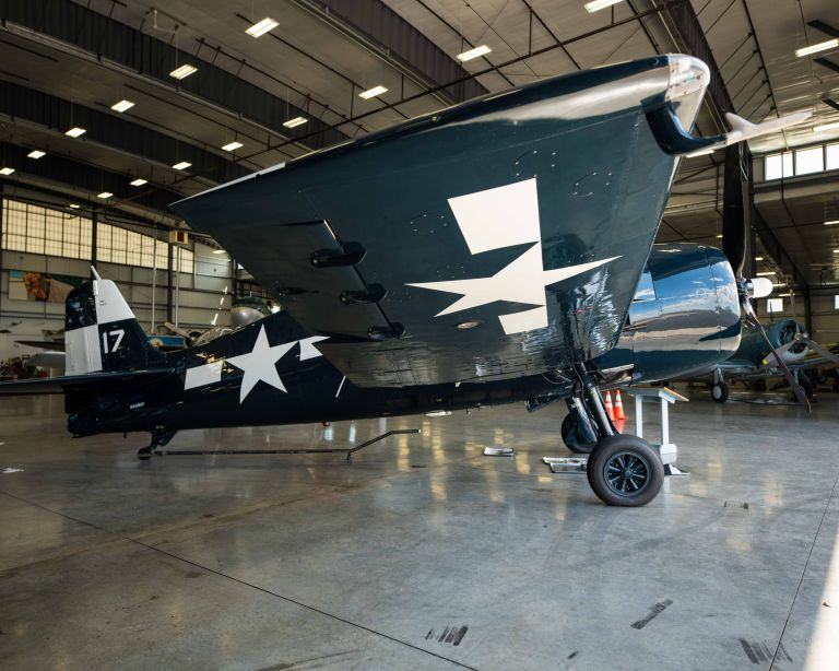 The side of the F6F-5N Hellcat Night Fighter plane, with a focus on the wing.
