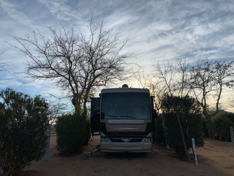 Beautiful sunrise and clouds behind the RV at the Kingman KOA>