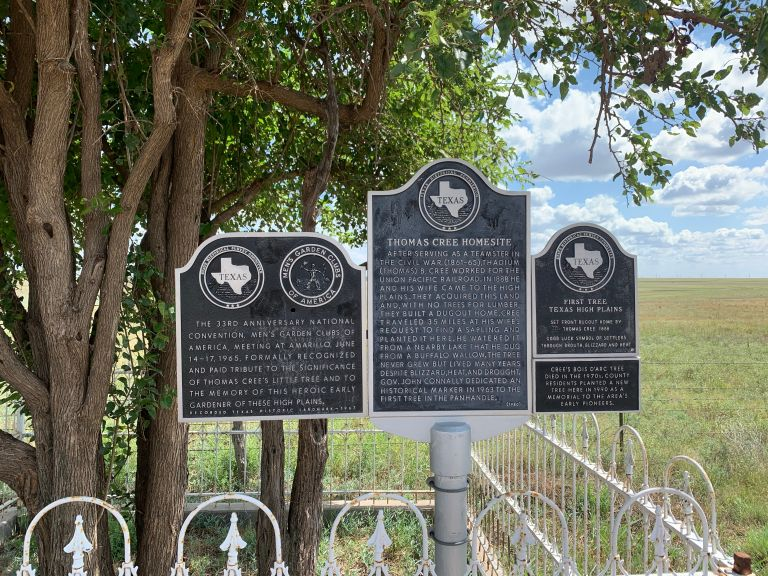 Three historical marker road signs.
