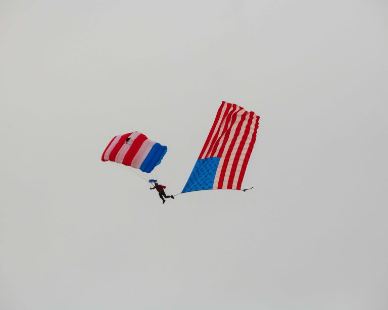One parachutist with the American flag.