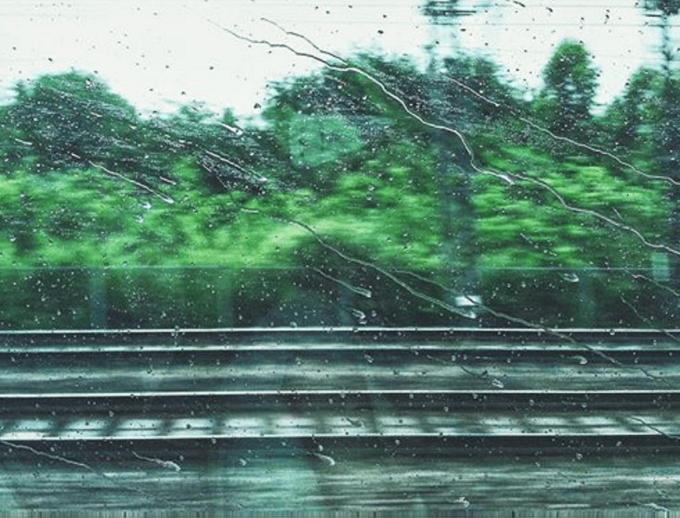 when on train, train, traveling, rain