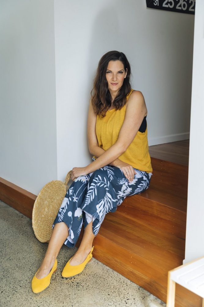 "Cait is wearing printed culottes, with a Kmart straw round bag and Ziera ""Lisa"" flat shoes"