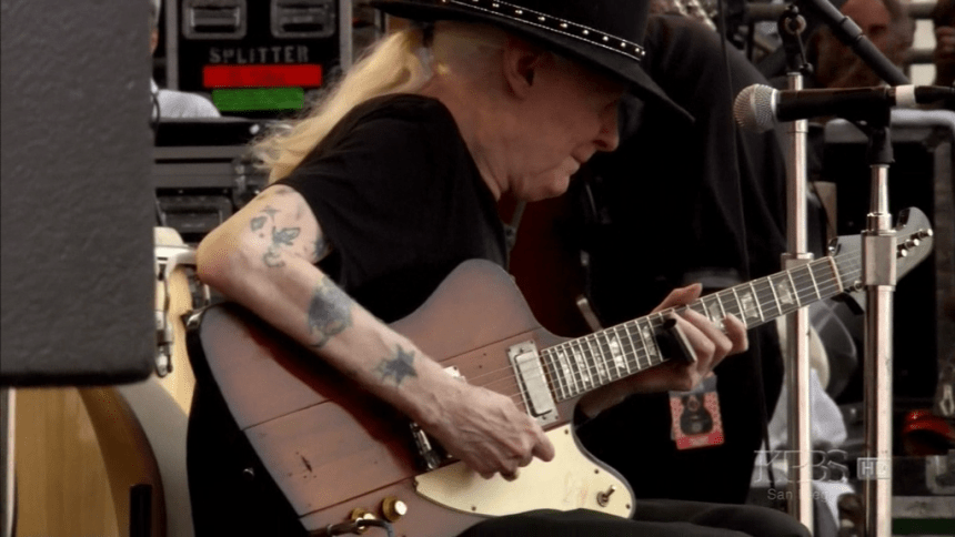 Johnny Winter with his 1963 Gibson Firebird V