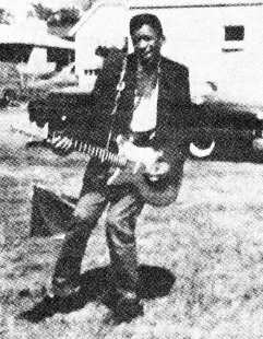 Young Jimi Hendrix with his Danelectro guitar