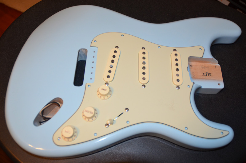 Fender Mint Green Pickguard with Aged White knobs and pickup covers