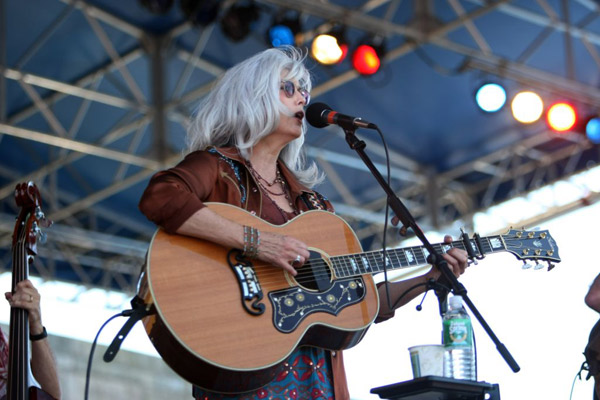 Emmylou Harris with her Gibson J-200 on stage at the Newport Folk Festival