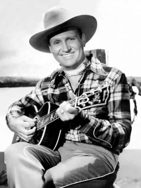 Gene Autry with dis custom orders small body Gibson flattop guitar