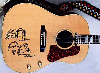Lennon guitar after he added
