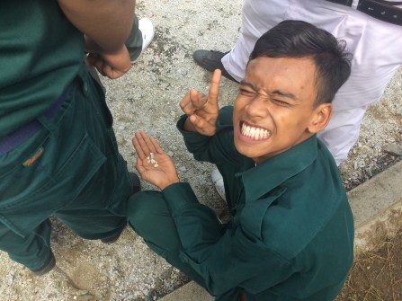 Nazmi collects his seven pebbles.