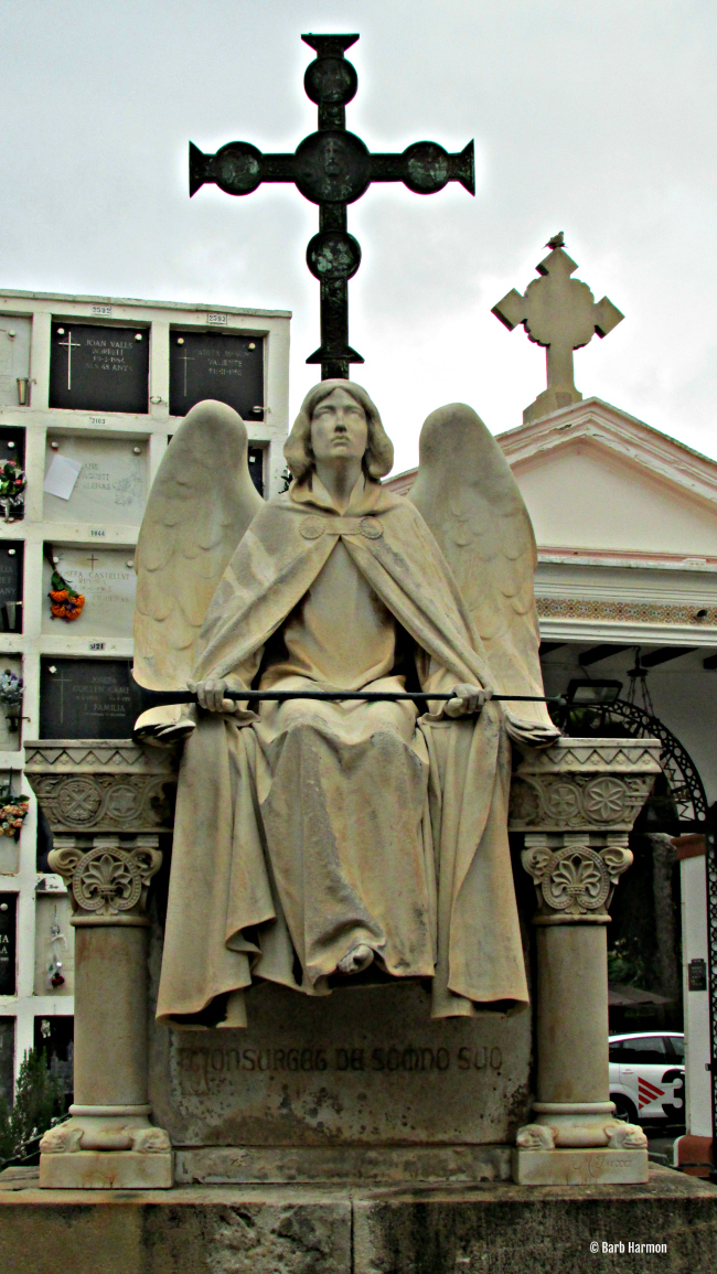 Sitting Angel tomb in Sitges, Spain
