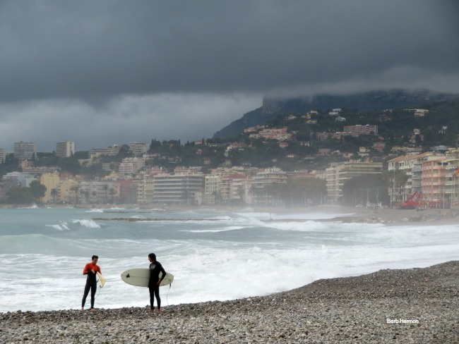 Surfers in Menton, France