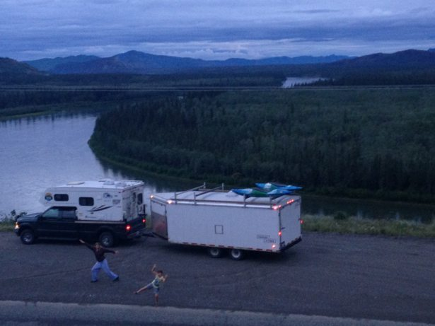 midnight with a Yukon River backdrop