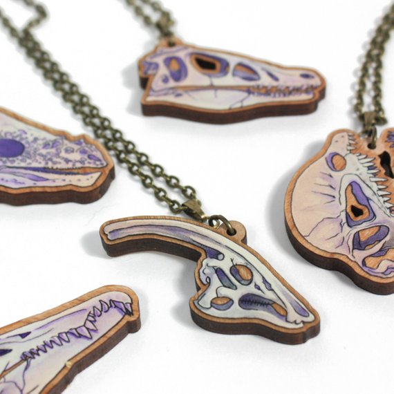 Assorted Dinosaur skull pendants by Sarah Wittig