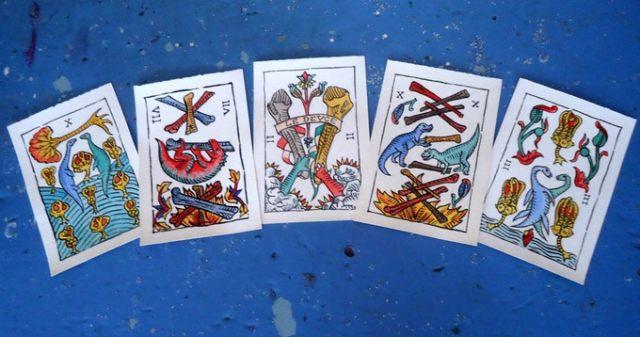Cards from the Dinosaures de Marseille Tarot Deck by Anastasia Kashian-Smith